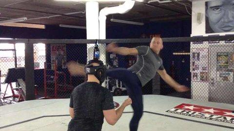 Watch Georges St. Pierre kick Bud Light bottle off fan's head