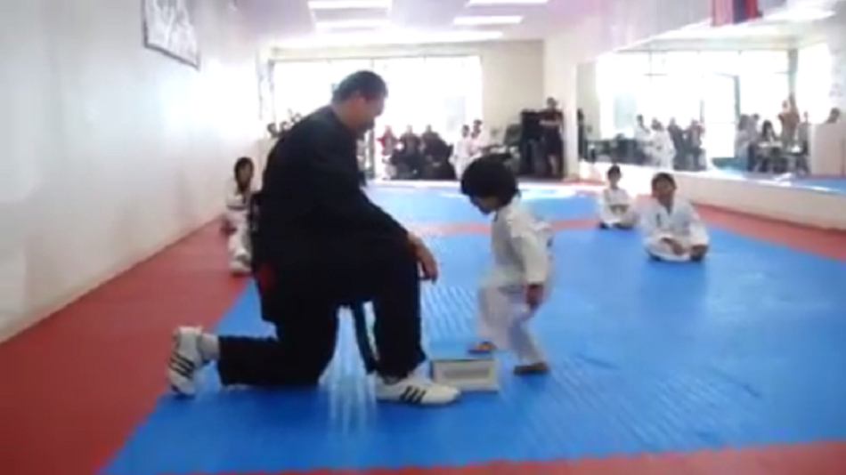 Watch little kid earn belt after learning to break board in Taekwondo
