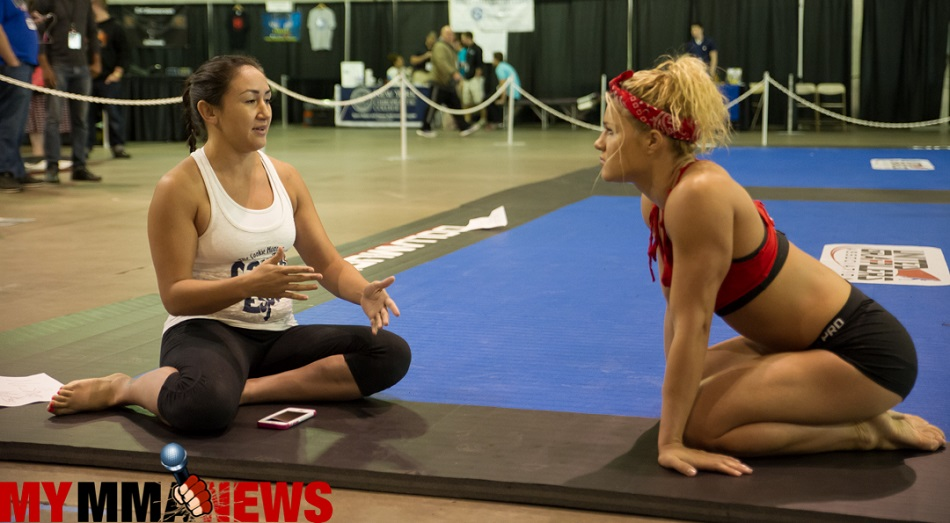 Carla Esparza and Felice Herrig at the MMA Classic Fan Expo in Syracuse, New York - October 2015. Photo by William McKee
