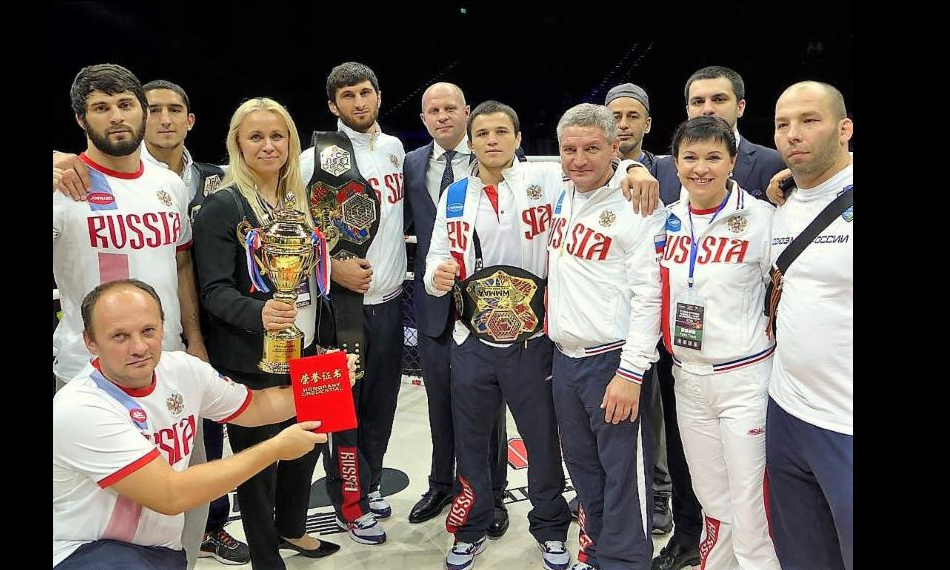 Team Russia celebrates its victory with (center) Fedor Emelianenko