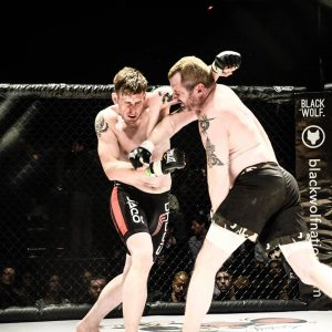 Jake Skelly (left) (article author) vs. Chris Tiernan at Victory Combat Sports 5 - Photo by Steve Bauzen