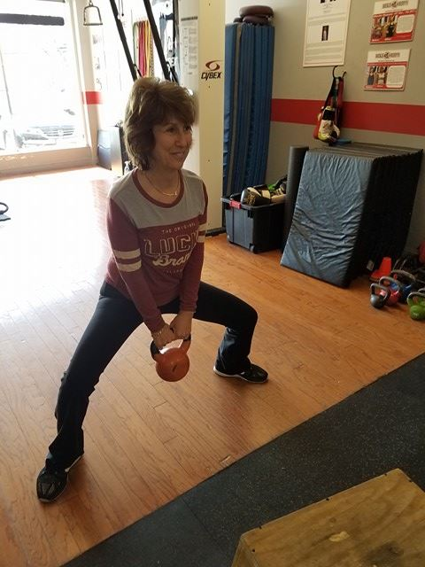 Amy doing sumo squats with high pull