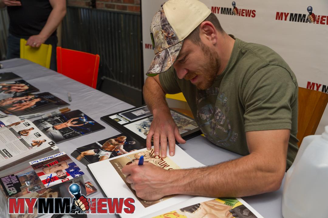 Jim Miller signs autographs for fans at Trackside Station Grill & Bar