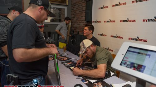 Jim Miller and Mickey Gall sign autographs for fans