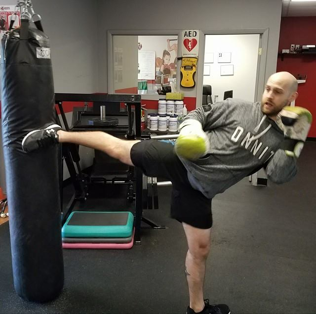 Brian doing the spinning side kick