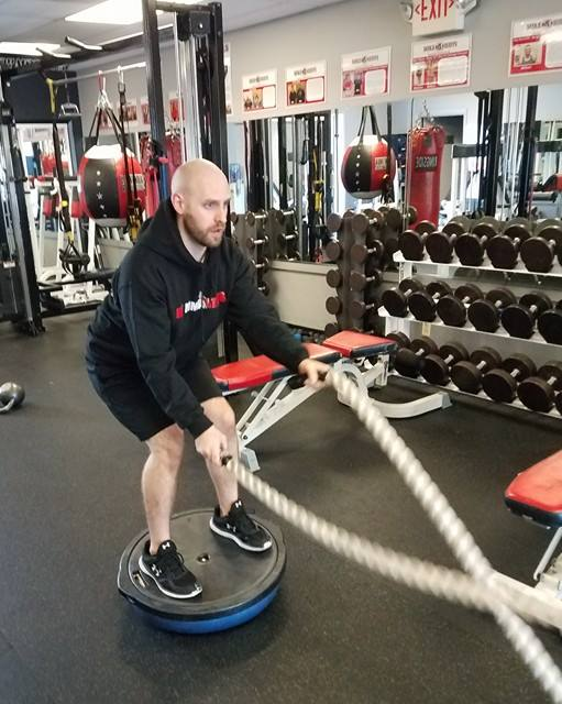 Brian doing rope slams on the bosu