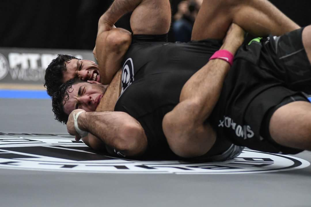 Felipe Pena sinking in a tight RNC on Buchecha.