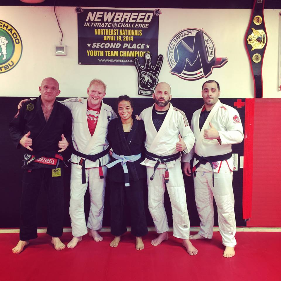 Criszaida Adames geting ready for battle at AOW 3 with help from extended Martinez BJJ family