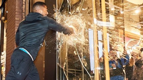 Boxing champ Anthony Joshua punches through glass at Under Armour store