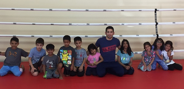 Abdul Kareem Al-Selwady trains children as he prepares for BRAVE 10