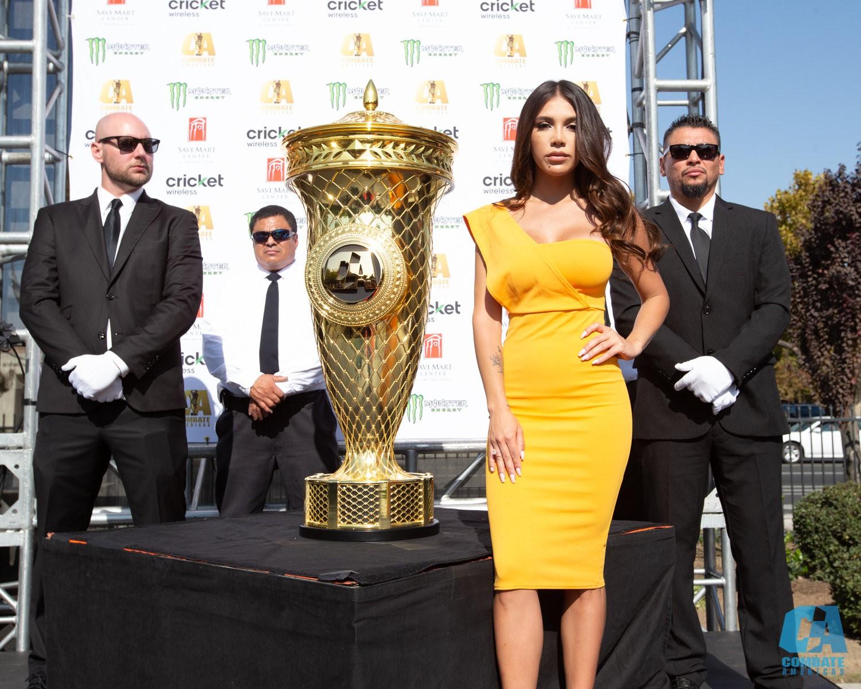 "Combate Americas' La Jaula model Alyshia Barragan with the ""COPA COMBATE"" winner's trophy"