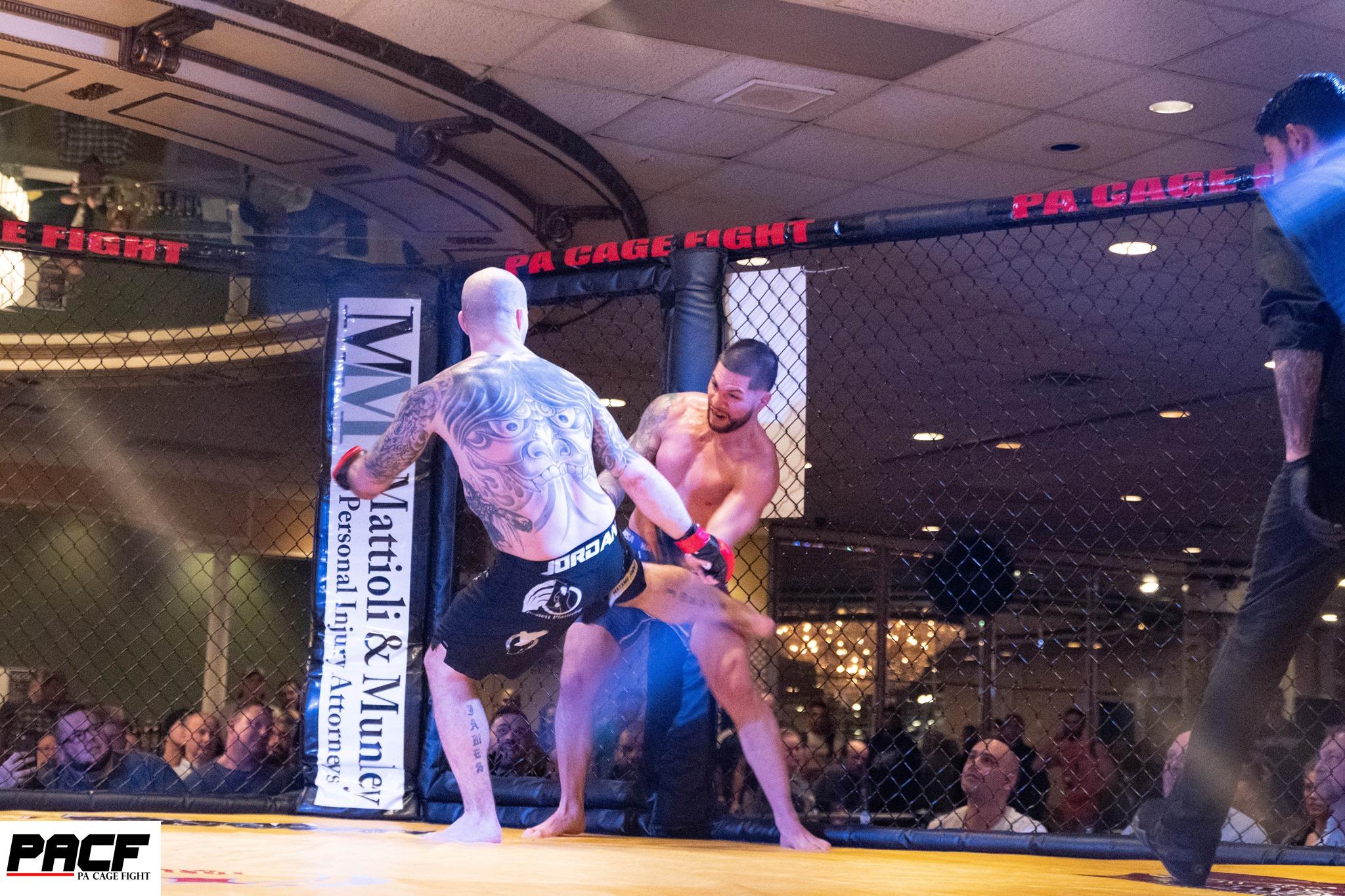 Jimmy Jordan chops the leg of Rick Nuno - PA Cage Fight 34 - Photo by LSS Photography