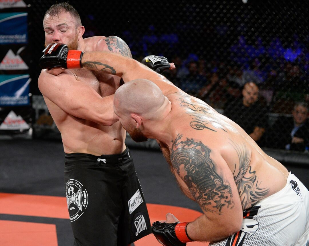 Hartford fans were thrilled when hometown hero Parker Porter (R) landed this punch - Photo by CES MMA Photographer Will Paul