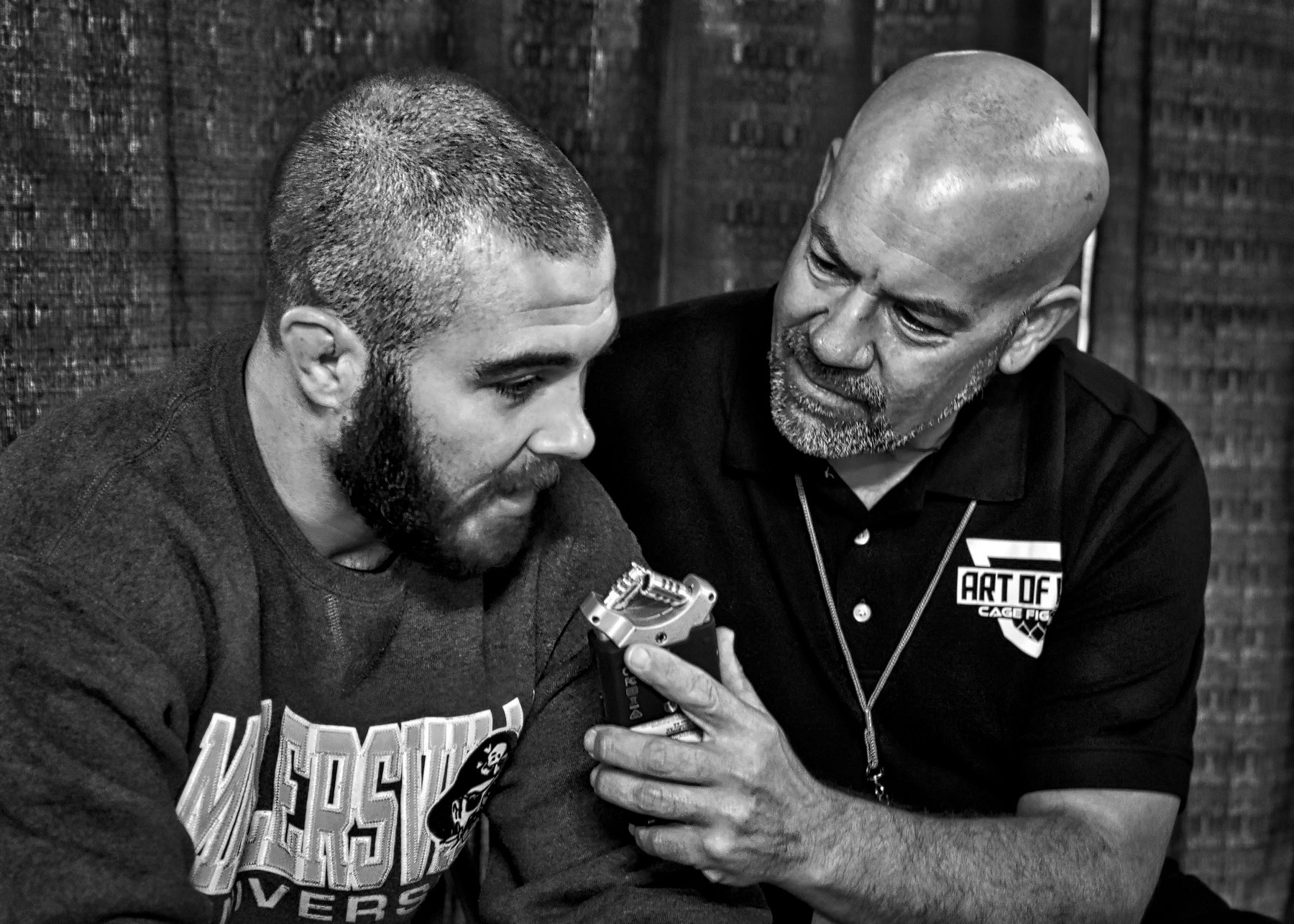 John Brennan speaks with Bob Meloni - Photo by Jamie McDonald for Art of War Cage Fighting.