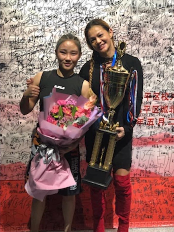Wang Lu Ping and Andy Nguyen following their fight at Beijing Combat