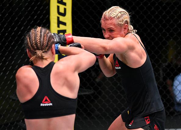 Yana Kunitskaya controls the fight against Julija Stoliarenko