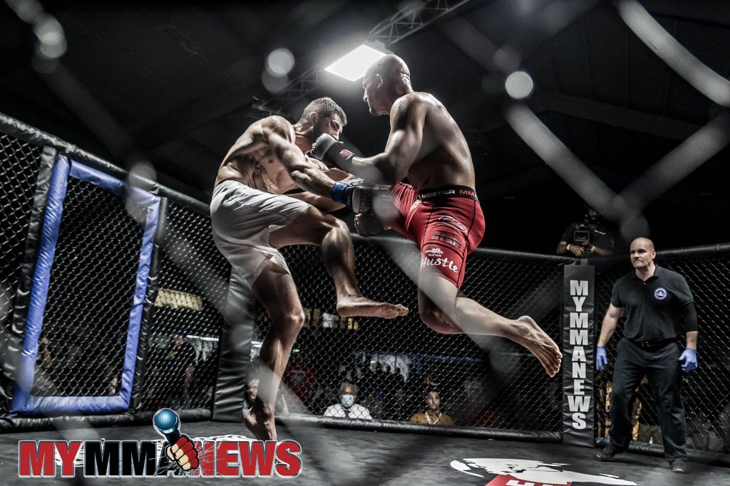 John Garbarino lands a kick on Robert Sousa right out the gate in the third round of their AOW 18 headlining title fight - Photo by William McKee for MyMMANews